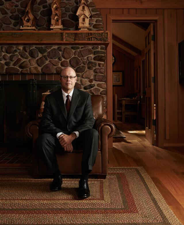 Image of Mark Orgel chairman and founder of Orgel Wealth Management, sitting in a chair